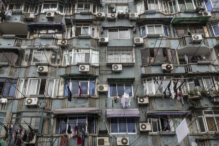 outside wall filled with air conditioners