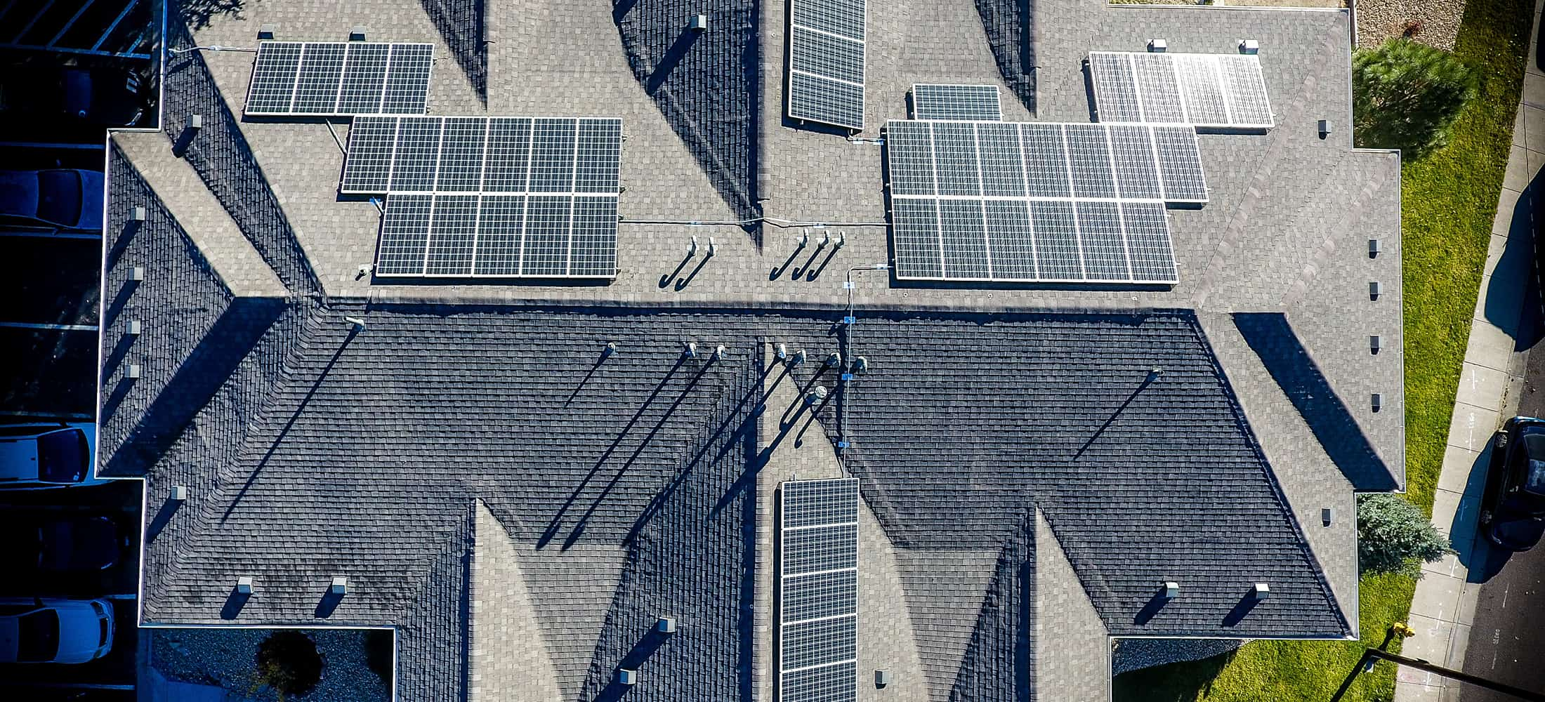 house roof full of solar panels seen from above